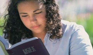 A-girl-reciting-holy-bible