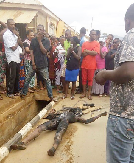 nigeria graphic photos of a man burnt to death for