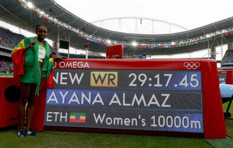 RIO DE JANEIRO, BRAZIL - AUGUST 12:  Almaz Ayana of Ethiopia celebrates winning the Women's 10,000 Meters Final and setting a new world record of 29:17.45 on Day 7 of the Rio 2016 Olympic Games at the Olympic Stadium on August 12, 2016 in Rio de Janeiro, Brazil.  (Photo by Ian Walton/Getty Images)